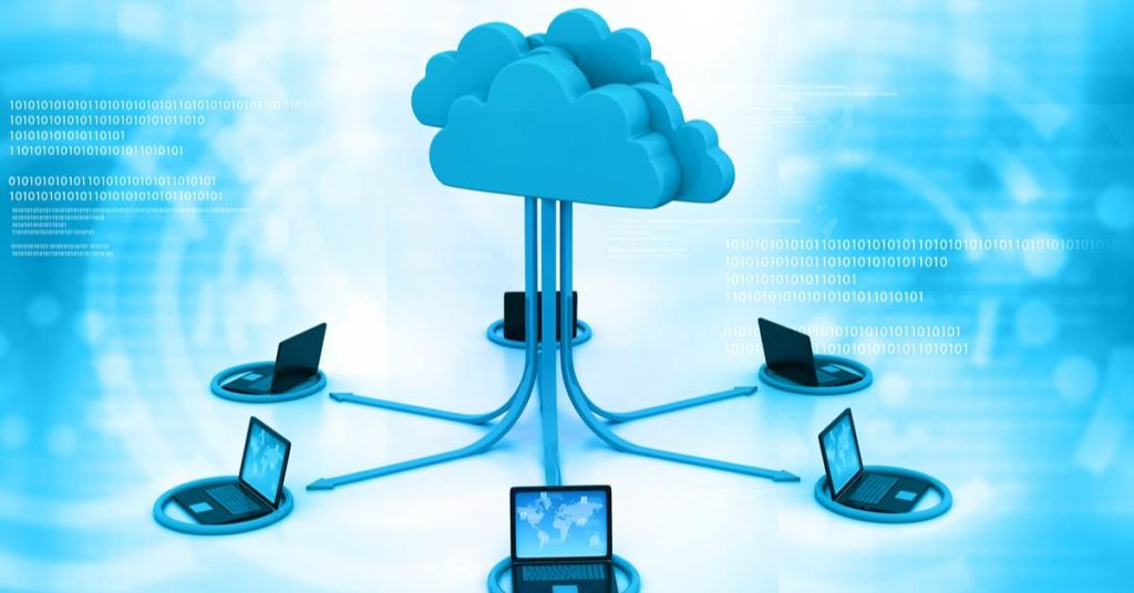 Six Laptops Connected by Cloud